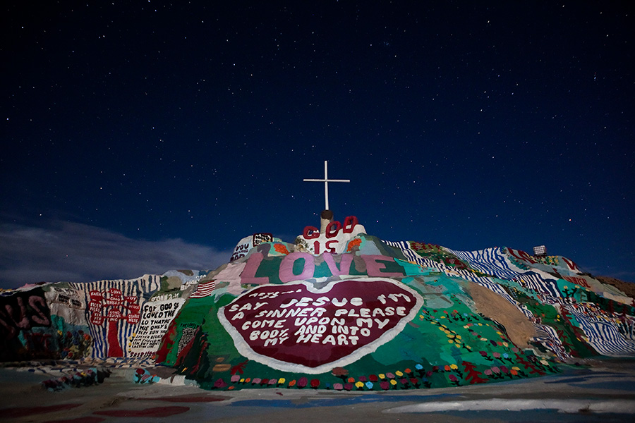 Salvation Mountain with stars at night, Slab City California